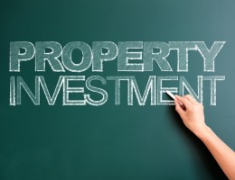 writing property investment on blackboard