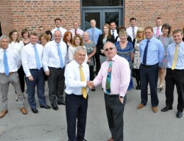 """Peter Johnston (left) and Neil Lamont in front of Legat Owen's """"incorporation team""""."""