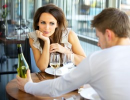 Woman In Love On Romantic Date in Restaurant** Note: Shallow depth of field