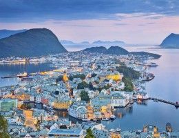 Image of norwegian city of Alesund during twilight blue hour.