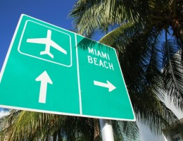 The sign showing direction to the airport and Miami Beach (Florida).