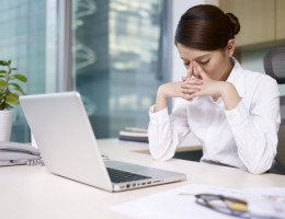 asian businesswoman sitting and thinking in office, looking tired.