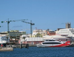 The waterfront of Hamilton Bermuda with one of the ferries in the harbour.