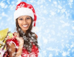 Christmas shopping smiling Santa woman . Over blue background