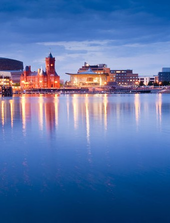 Pretty night time illuminations of the stunning Cardiff Bay many sights visible including the Pierhead building (1897) and National Assembly for Wales.