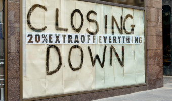 Closing down sign in a city centre shop.