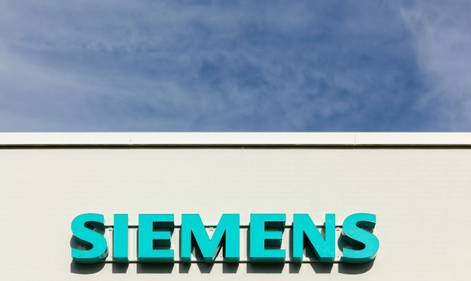 Aarhus, Denmark - August 8, 2015: Siemens logo on a facade. Siemens is a german multinational conglomerate company headquartered in Berlin and Munich. It is the largest engineering company in Europe. The principal divisions of the company are industry, e