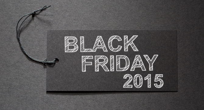 Black Friday 2015 text on a black tag on black paper background