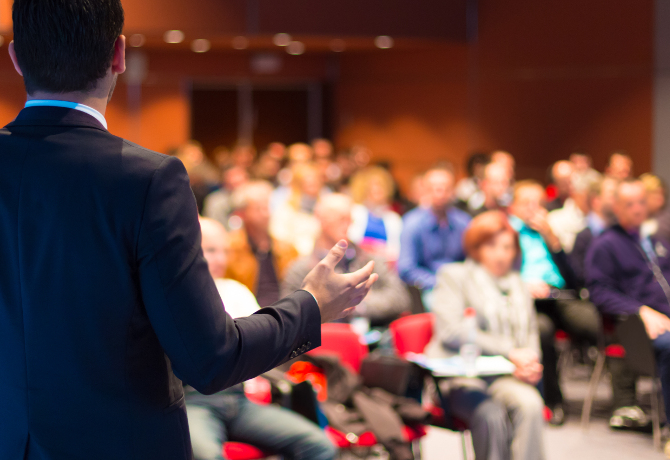 Speaker at Business Conference and Presentation. Audience at the conference hall. ** Note: Shallow depth of field
